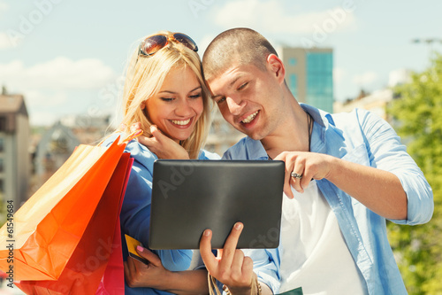 Happy young couple shopping online