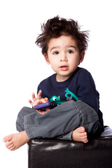 Cute boy sitting with mobile device