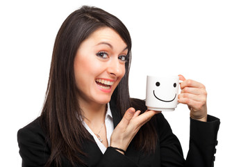 Businesswoman holding a cup with a smile