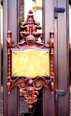 Wooden door with bronze plaque