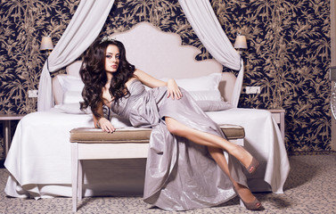 beautiful woman with black hair in luxury interior