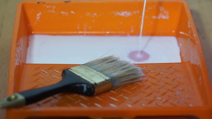 Primer is poured into a paint tray