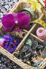 full wicker basket with sewing tools and accessories