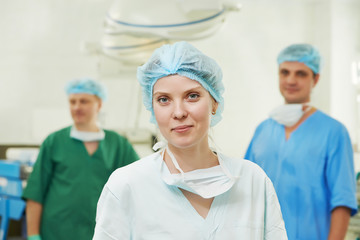 surgeons team in surgery operation room