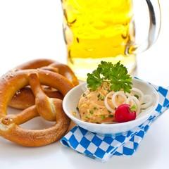 Fresh german pretzels with obatzda and beer