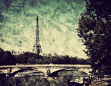 Eiffel Tower and bridge on Seine river in Paris, France. Vintage