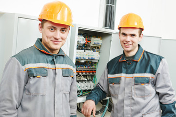 happy electrician engineer workers