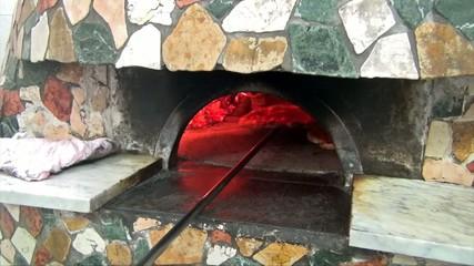Pizzaiolo baking pizzas