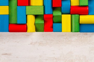 Toys blocks, multicolor wooden colorful bricks background