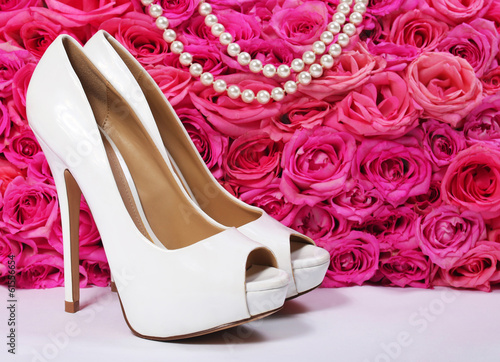 Bridal Shoes and Roses. White Heels over Hot Pink Flowers