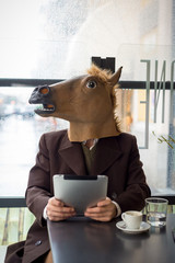 young stylish man lifestyle horse mask