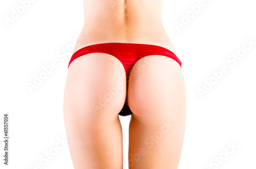 Perfect female sexy tanned buttocks in red lingerie - 61557034
