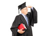 Male college professor in graduation gown looking