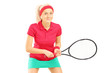 Young female tennis player holding a racket