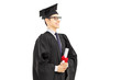 Young male graduate student holding a diploma