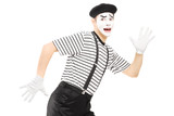 Scared male mime artist running away