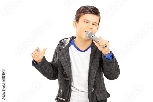 Boy singing on microphone