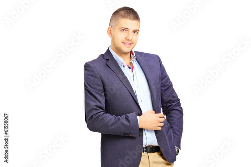 Young fashionable man leaning against a wall