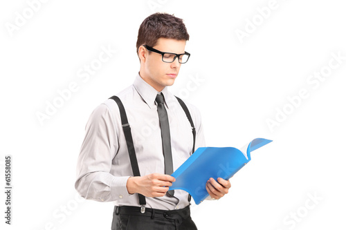 Young man reading papers