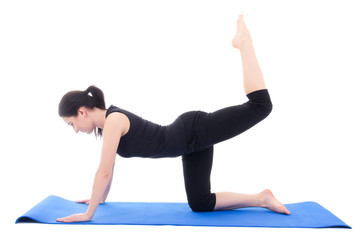 young attractive woman doing fitness exercise on blue yoga mat i