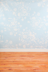 Room with blue vintage wall paper