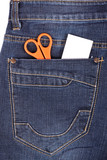 Scissors and sticker in the blue jeans pocket