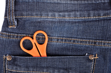 Scissors in the blue jeans pocket