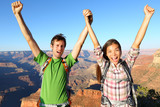 Happy people celebrating cheering in Grand Canyon