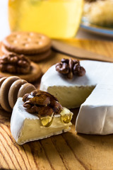 Camembert dipped with honey and walnuts