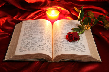 Ooen bible and red heart candle