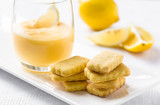 Stack of cookies and lemon curd in glass