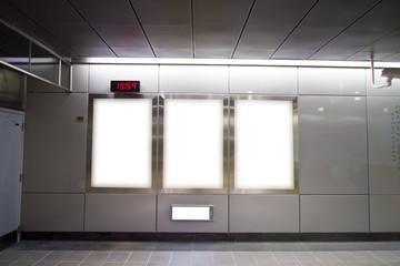 Blank billboard in metro station