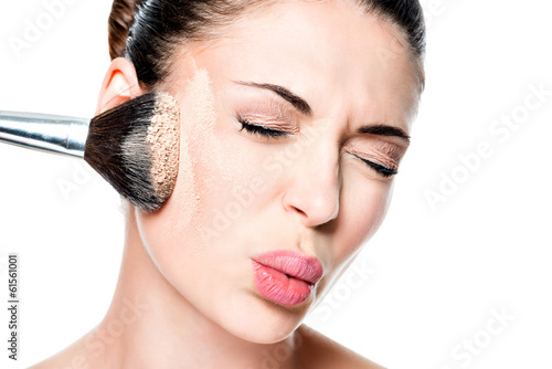 woman with  powder on the skin of cheek