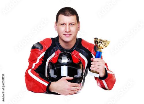 Deurstickers Fietsen motorcyclist holding the trophy closeup portrait