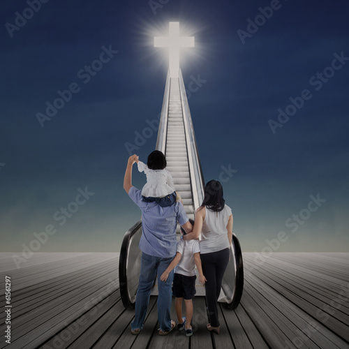 Asian family looking at cross