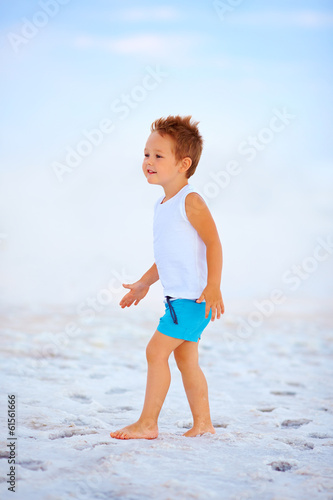 cute boy walking the salted lake firth