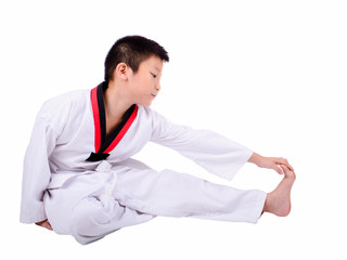 Young boy training taekwondo action isolated