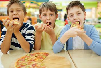 Boys in pizzeria