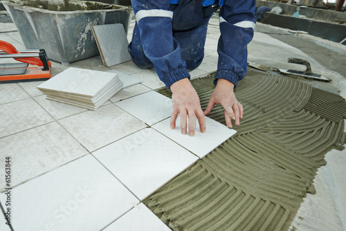 tilers at industrial floor tiling renovation