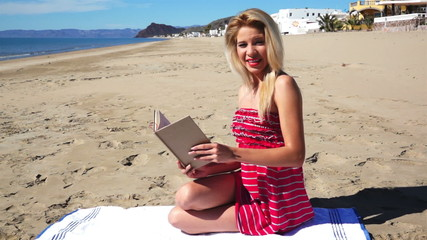 Girl on Beach in Sundress Reading