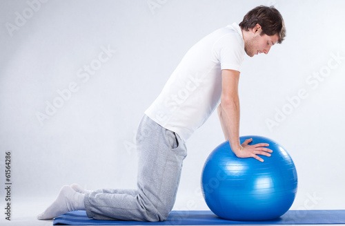 Rehabilitation exercises on fitness ball