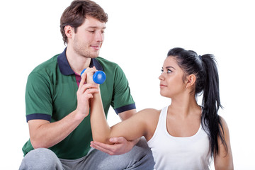 Physiotherapist doing exercise with his patient