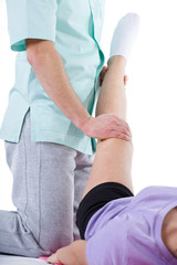 Leg stretching at physiotherapy cabinet