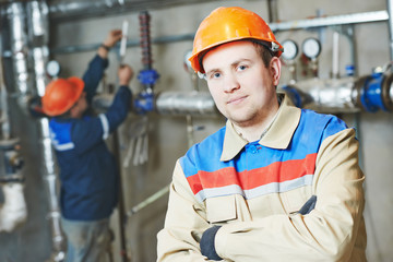 heating engineer repairman in boiler room