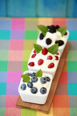 Summer, seasonal fruits from garden with yogurt