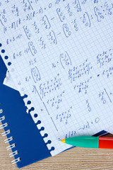 Math on copybook page closeup