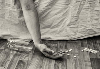 Suicide with pills. Drug abuse concept