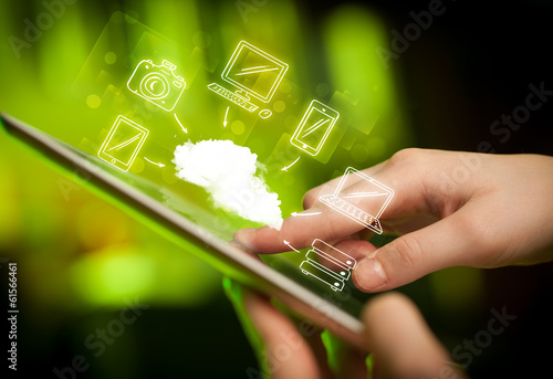 canvas print picture Finger pointing on tablet pc, mobile cloud concept