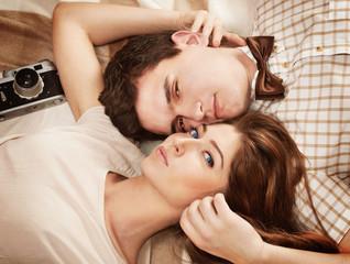Beautiful vintage style sensual couple lying on the blanket