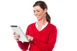 Smiling woman operating touch pad device